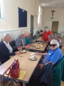 Parish members enjoying their frugal lunch of bread and soup